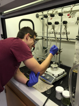 Nathan sets up an air-free reaction on the Schlenk line.