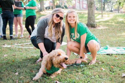 Zeta Phi sisters with a furry friend.