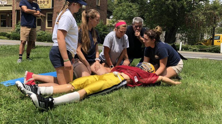 Students working with paramedics to learn best emergency care practices