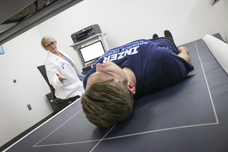 Young man having a DEXA scan with Dr. Kilbourne