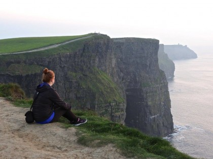 Taylor Moxley overlooking the Atlantic Ocean in Ireland.