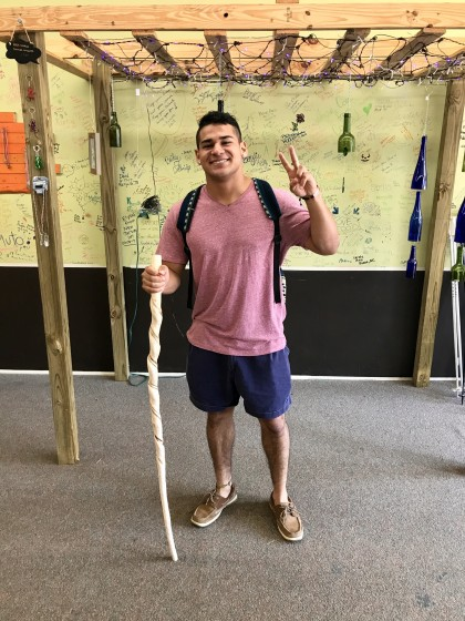New student, George Jones, buys his first ever hiking stick!