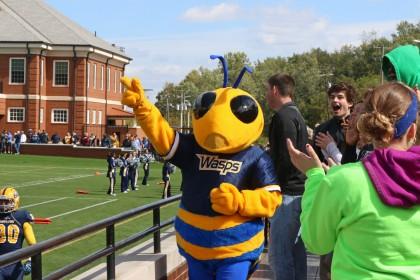 Go Wasps! Our mascot rallies the crowd at a football game.