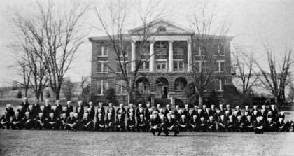 Navy personnnel pose in front of Weaver Hall.