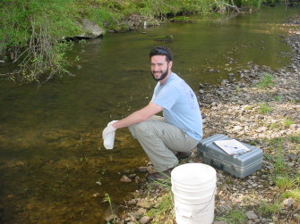 Alumnus Michael Swanger monitors a stream as part of his job for the Tennessee Dept. of Environmental Quality