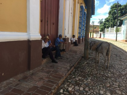 Locals enjoying their day in Trinidad, Cuba, a place known for its cobblestone streets and long c...