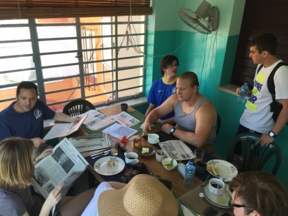Reading the news while having breakfast at Estudio Sampere La Habana, before Spanish language cla...