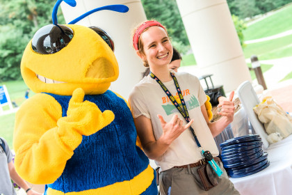 First-year student poses with the school mascot, Stinger.