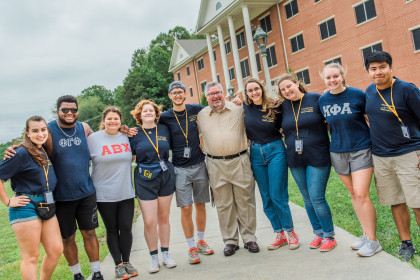 John Wells with students during Move-in Day.