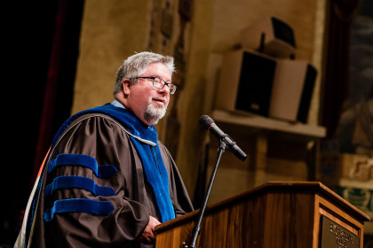 John Wells speaks at the School of Health Sciences commencement.