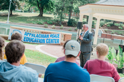 John Wells speaks during a rally for Climate Change.
