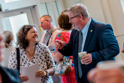 John Well speaks with faculty during Opening Week.
