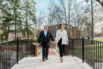 John Wells along wife Shannon walk on campus.
