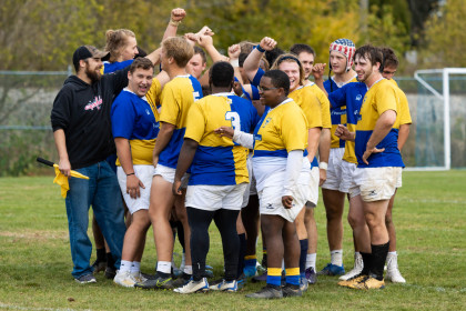 The E&H Men's Rugby team huddles up.