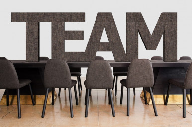 Conference room table with chairs and the word team