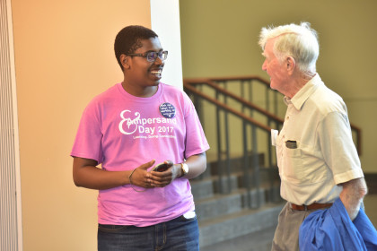 Ambassador Sam Mungai, '20, at speaking with a visitor at Ampersand Day 2017.