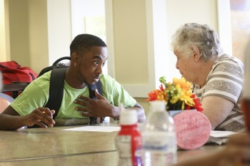 An Emory & Henry student serves at a local retirement facility.