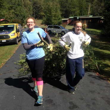 Emory & Henry students clearing invasive species during an Intentional Fall Break Trip.