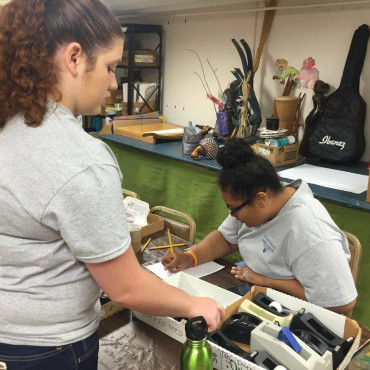 Emory and Henry students serve at a local arts organization.