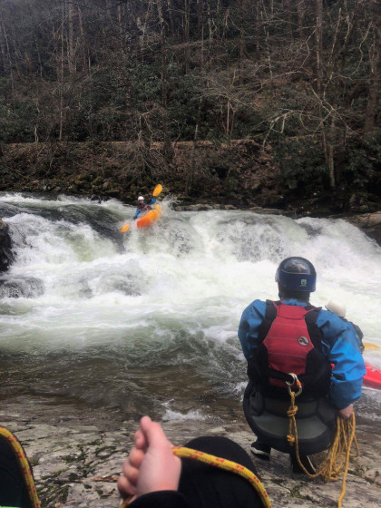 Kaelee Belletto kayaking a rapid called Big Rock on Whitetop Laurel Creek.