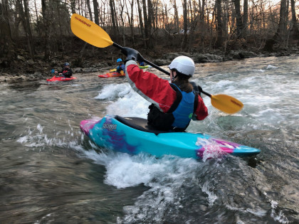 Surfing in a kayak on the South Fork of the Holston River.