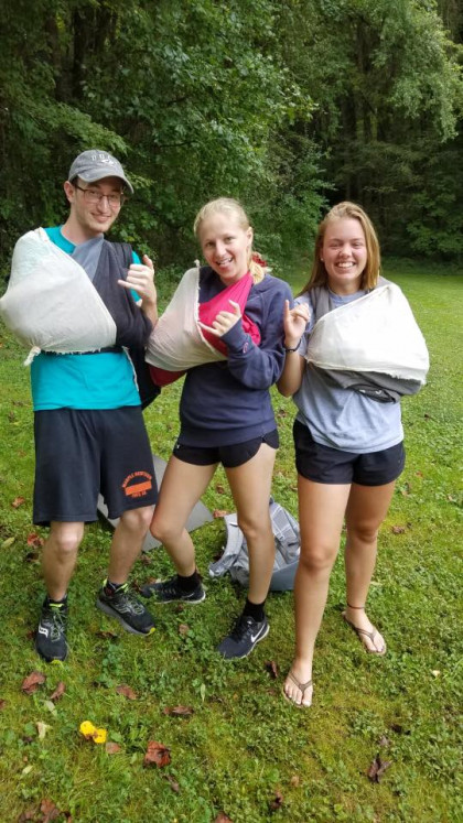 "Laurel (right) and Adventure Teammates show their ""Stingers Up"" during a Wilderness Fir..."
