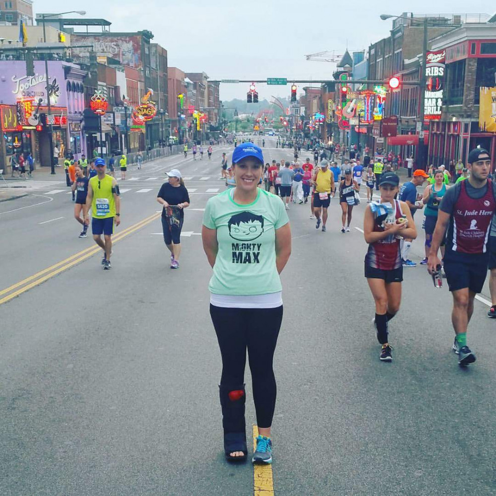 Emily Tolley Boyles at the Nashville Rock n Roll Marathon...wearing her orthopedic boot.
