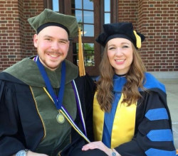 Cortney Halsey and Jeremiah Jessee in full academic regalia.
