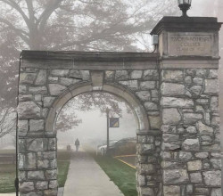 E&H campus gates on a foggy morning.