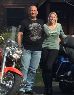 Juan and Tracy Walker Garcia with their motorcycles.