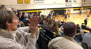 Pam Kestner cheers for E&H in Ashland as the men's basketball team takes on Randolph-Macon.