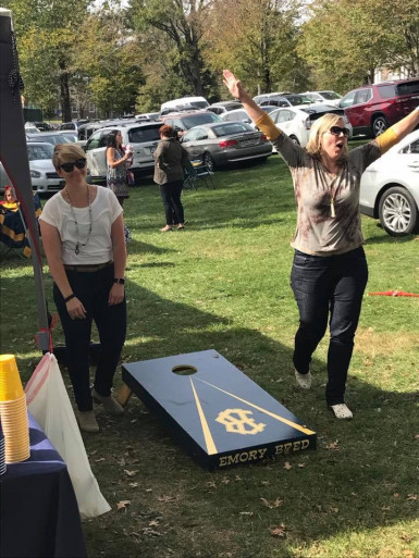 Alumni playing corn hole during a homecoming tailgate.