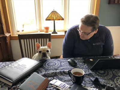 Mark Lambert is taking orders from his canine assistant.