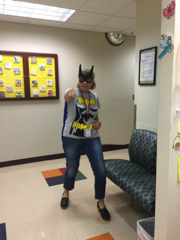 Cathy Botrell will go to extremes to cheer up her friends at work: even if it means dressing like...