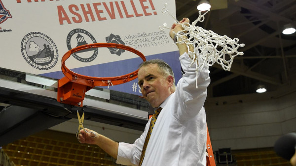 Mike Young (E&H '86) cutting down the net after his Wofford team won the 2019 SOCON cham...