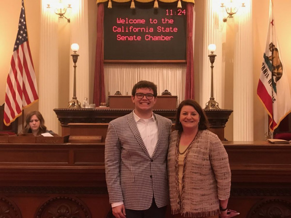 Cameron Chase and Toni Atkins on the floor of the California Assembly.