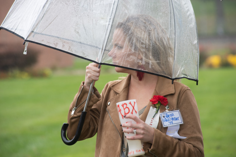 Rain never stopped a good E&H Homecoming; this young woman managed to find an umbrella that h...