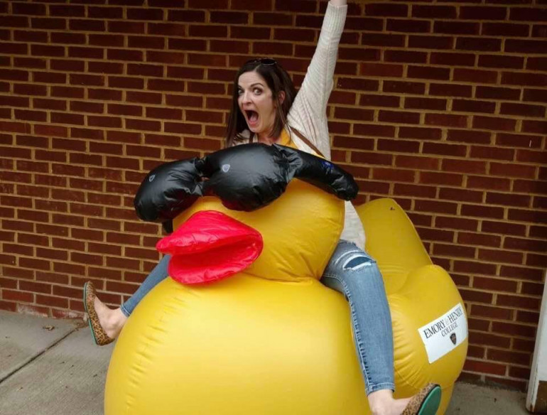 Sara Peters Schill takes a ride on the giant rubber ducky to celebrate a great 2019 Homecoming.