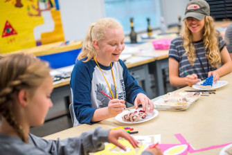 Students at Emory & Henry's Summer Scholars Institute camp enjoy making art.