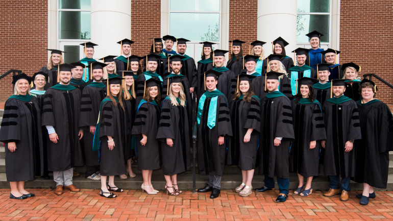 2018 DPT Graduating class with Faculty in front of MCA