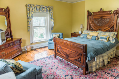 Room 203 features a queen sized bed with use of main bath.