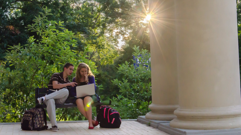 Students study in front of Wiley Hall.