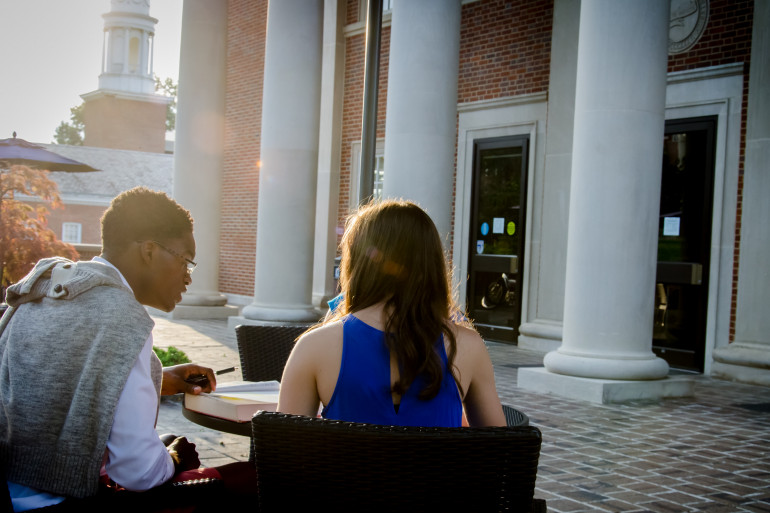 Honors scholars study in front of the library on campus