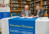 President Jake Schrum, left, and Assistant Superintendent Dr. Jeff Noe sign the agreement for the...