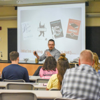 Travis Proffitt teaches honors transitions class