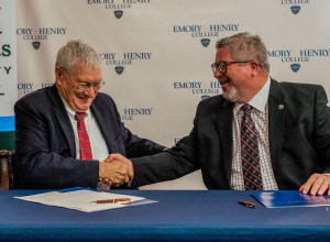 Interim President Charles White (VHCC) and President John Wells (E&H) signing the Concurrent ...