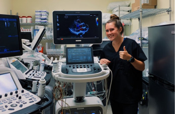 Erica Grupp and the echocardiograph she used.