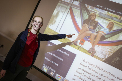 Student Sara Foster points to her photograph on the new website.