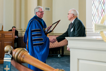 Henry Dawson accepts his college citation from President Schrum.