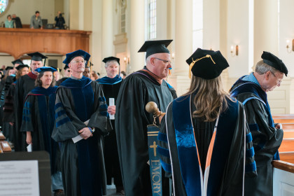 Faculty process in at Founders Day.